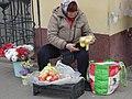 Kaluga, trading apples to survive (23657875618).jpg