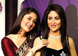 Kareena Kapoor stands beside her wax sculpture