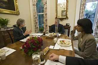 Karen Hughes - Karen Hughes (L) at White House luncheon with President George Bush (C) and United States National Security Advisor and United States Secretary of State Condoleezza Rice (R).