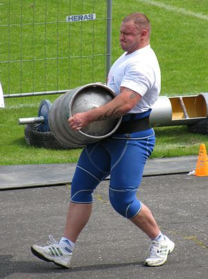 English: Strongmen event: the Keg Race (for time).