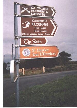 Kilcummin - Signpost on the Lacken Road showing variant Irish spelling