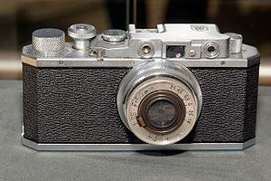 Canon Inc. - Image: Kwanon camera (replica) front 2016 Canon Plaza S