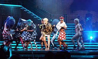 "Shocked (song) - Minogue and her dancers performing ""Shocked"" during Showgirl: The Homecoming Tour (2006)."