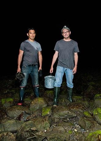 Bun Lai - Chef Bun Lai and conservation biologist, Dr. Joe Roman, hunting for invasive Asian shore crabs in Connecticut.