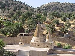 Conical roofs characteristic of Yazidi sites mark the tomb of Şêx Adî in Lalish