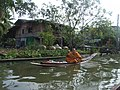 Lama on his way to a daily errand on a typical Thai waterway in Demnoen Saduak Sai Noi Thailand - panoramio.jpg