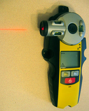 Laser line level - Typical consumer laser line level using spirit levels for three planes and including a digital stud sensor display.