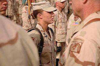 Leigh Ann Hester - Hester waits to receive her Silver Star medal during a military awards ceremony at Camp Liberty, Iraq in June 2005.