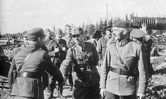 Karl Lennart Oesch - The reconquest of Viipuri in 1941. Oesch and his chief-of-staff colonel Valo Nihtilä. Lot of pillaged Soviet materiel in the background.