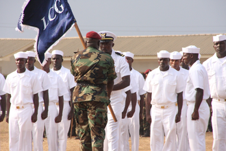 Suraj Abdurrahman - Abdurrahman, as Command Officer-in-Charge of the AFL, hands over a guidon to personnel of the reactivated Liberian National Coast Guard, 16 April 2010.