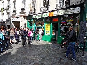 L'As du Fallafel - A line of tourists and locals waiting to buy L'As Du Fallafel's popular falafel sandwich during the busy lunch hour.