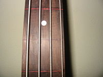 This bass was built by the Luthier Nathaniel Miller