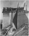 Looking east along the axis of the dam at a section of the spillway structure showing the cut-off wall between the... - NARA - 295309.tif