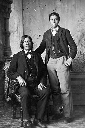 Luther Standing Bear - Luther Standing Bear with his father, George Standing Bear, at Carlisle Indian School, c. 1880