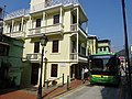 Macau 告利雅施利華街 Rua Correia da Silva green single deck bus 3-floor tang lau apartments Oct-2015 DSC 耶都地巷 Travessa de Santa Gertrudes.JPG