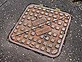 Mallon's manhole cover, Lisburn (2010) - geograph.org.uk - 2030250.jpg