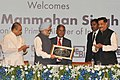 Manmohan Singh being received a memento, at the Silver Jubilee Celebrations of the Securities and Exchange Board of India (SEBI), in Mumbai. The Governor of Maharashtra.jpg