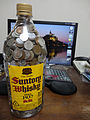 Many Japanese coins in the 2700ml Whisky PET bottle for saving.jpg