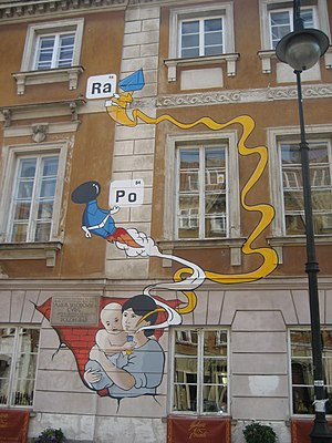 Maria Skłodowska-Curie Museum - Mural on birthplace, painted 2011 on 100th anniversary of second Nobel Prize. Mural shows (infant) Maria holding a test tube from which emanate the elements she discovered: polonium and radium.