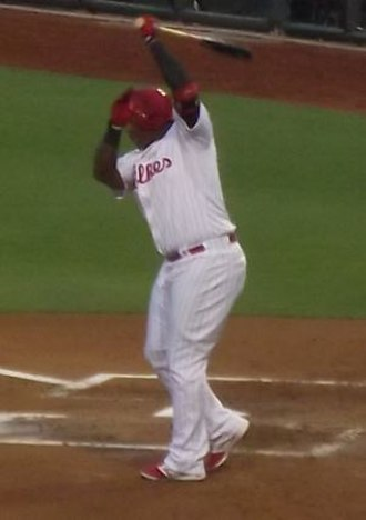 Marlon Byrd - Byrd takes a practice swing in a 2014 game
