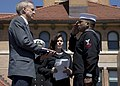 Mass Communication Specialist 2nd Class Danian Douglas presents Illinois Gov. Bruce Rauner with a flag flown over Abraham Lincoln's grave. (17025352778).jpg