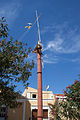 Mast in front of the church of the patron saint of sailors in Symi.jpg