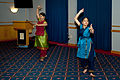 Meenakshi Ganesan and Lakshmi Vemun demonstrate dances from India during an Asian Pacific American Heritage Month observance at Fort McCoy.jpg