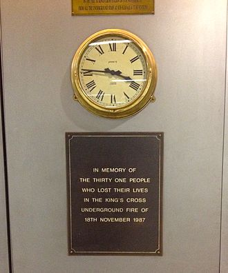 King's Cross St. Pancras tube station - Memorial plaque with the clock to the 1987 fire in the station