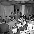 Men in suits in restaurant in China circa 1940s.jpg