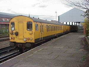 Merseyrail - 73 901 between two former Class 501 driving cars with a de-icing train at Chester on 26 March 1999