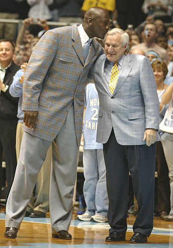 Michael Jordan (left) played basketball under Dean Smith (right) while attending the University of North Carolina. Jordan helped the Tar Heels win the 1982 NCAA Championship with a game-winning jump shot. MichaelJordanDeanSmith.jpg