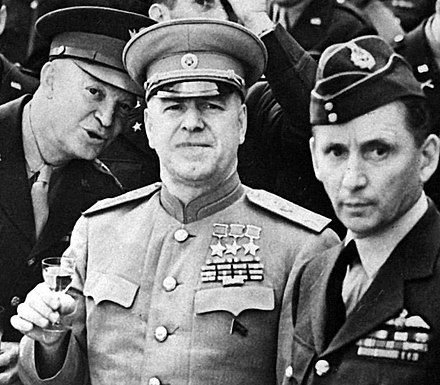 Dwight Eisenhower, Georgy Zhukov and Arthur Tedder on June 5, 1945. Montgomery receives Order of Victory HD-SN-99-02756 cropped.JPG