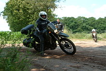 Motorcycle in rough terrain.jpg
