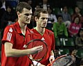 Murray bros look at rackets.jpg