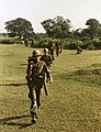 NARA 111-CCV-569-CC44319 4th Infantry Division soldiers moving across open field Quang Ngai 1967.jpg