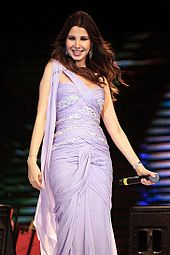 962f1a0e2c5ca Ajram performing at a concert in December 2012