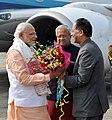 Narendra Modi being received by the Governor of Assam, Nagaland & Tripura, Shri Padmanabha Balakrishna Acharya and the Chief Minister of Assam, Shri Tarun Gogoi, on his arrival at Dibrugarh, Assam on February 05, 2016 (1).jpg