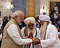Narendra Modi interacting with the Freedom Fighters, during the 'At Home' function, hosted by the President, Shri Ram Nath Kovind, on the occasion of 76th Anniversary of the Quit India Movement, at Rashtrapati Bhavan (6).JPG