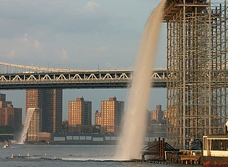 Olafur Eliasson - Waterfall under the Brooklyn Bridge. The bridge in the background is the Manhattan Bridge.