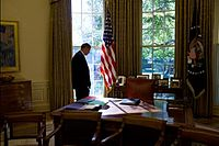 Obama standing in the Oval Office.jpg