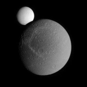 Natural satellite - Two moons: Saturn's natural satellite Dione occults Enceladus