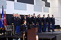 Oregon State University ROTC cadets stand during the playing of the National Anthem (9070933993).jpg