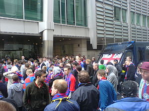 Crystal Palace fans protest - and await anxiously for news - outside the Lloyds HQ in London on 1 June 2010. Palace fans protest outside Lloyds HQ in London.JPG