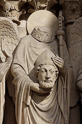 Denis - Saint Denis holding his head. Statue at the left portal of Notre Dame de Paris.