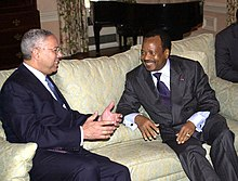 Colin Powell and Cameroon president Paul Biya, smiling and talking