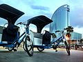 Pedicabs in action on Barcelona beach.jpg