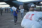 Philippine forces lead relief effort in Ormoc (Image 2 of 2) (10928070794).jpg