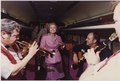Photograph of First Lady Betty Ford Dancing to the Music of Musicians Traveling with the Presidential Party Across... - NARA - 186829.tif