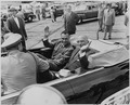 Photograph of President Truman and President Galo Plaza of Ecuador waving from the back of their limousine, during... - NARA - 200301.tif