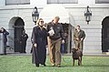 Photograph of President William Jefferson Clinton and First Lady Hillary Rodham Clinton with Buddy the Dog en route to Marine One- 03-13-1998 (6461530431).jpg